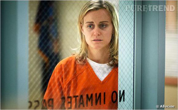 """""""Orange is the new Black"""" : Taylor Schilling incarne une jeune femme enfermée après avoir transporté de l'argent sale."""
