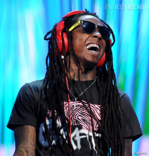 Lil Wayne a l'air content, ça tombe bien, comme ça il peut montrer son grillz !