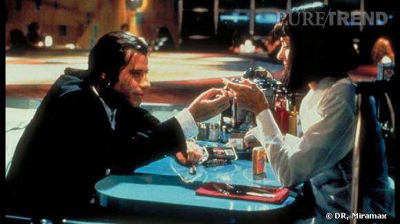 "John Travolta la porte dans ""Pulp Fiction""."