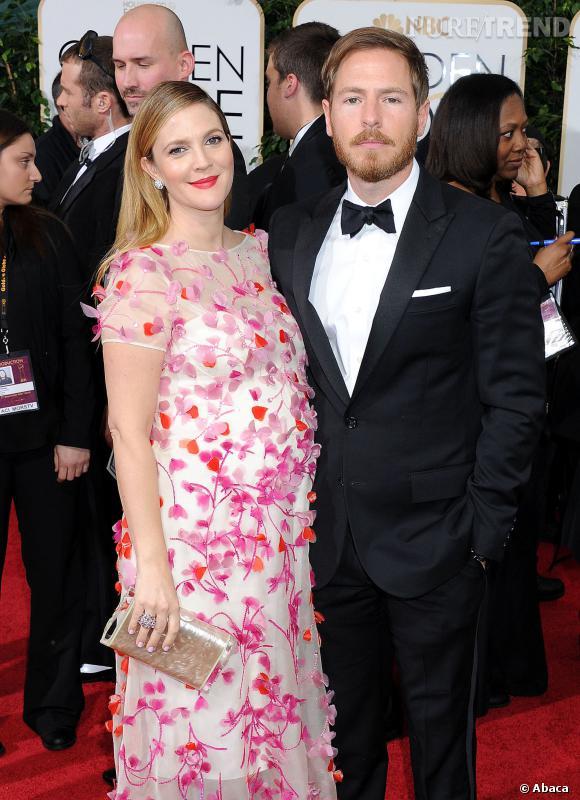Drew Barrymore à la cérémonie des Golden Globes 2014 avec son mari Will Kopelman, en robe Monique Lhuillier.