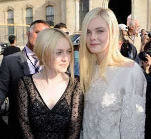 Elle et Dakota Fanning lors du défilé Louis Vuitton de la Fashion Week Paris, le 2 octobre 2013.