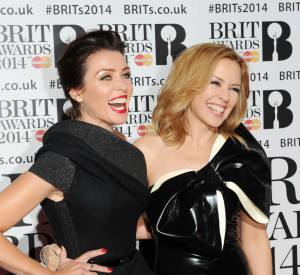 Danni Minogue et Kylie Minogue lors des Brit Awards 2014.