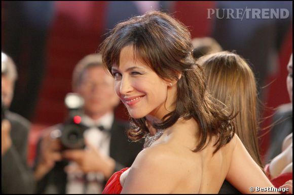 Sophie Marceau a été élu parisenne de l'année 2014 par les lecteurs du Figaro. Ici l'actrice nous fait un clin d'oeil complice au Festival de Cannes en 2009.