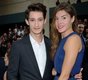 Pierre Niney et Natasha Andrews au défilé Dior Homme Printemps-Eté 2015 à Paris.