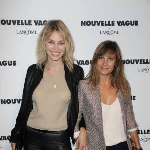 Pauline Lefèvre et l'actrice Julie de Bona lors de la soirée Nouvelle vague by Lancôme le 9 juillet 2014 à Paris.