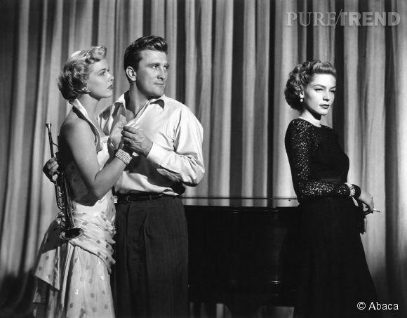 """Lauren Bacall face à Doris Day et Kirk Douglas dans """"La Femme aux chimères"""" en 1950."""