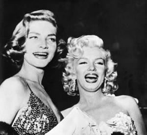 Lauren Bacall et Marilyn Monroe photographiées en 1954. Deux icônes aujourd'hui disparues.