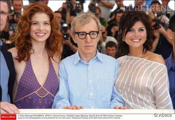 """Tiffani Thiessen avec Woody Allen et Debra Messing lors du photocall du film """"Hollywood Ending"""" au Festival de Cannes de 2002."""