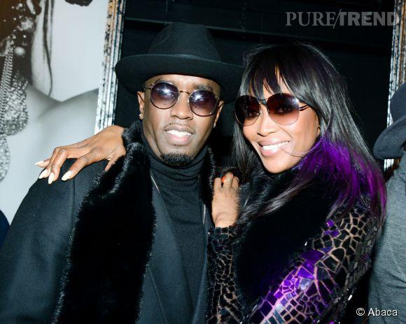 Diddy n'était pas peu fier de poser aux côtés de la panthère, Naomi Campbell.