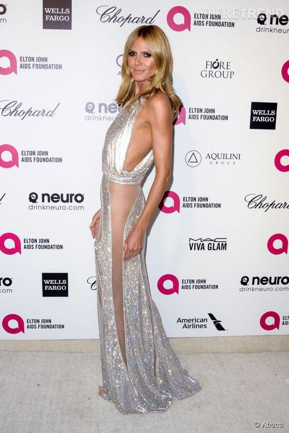 Heidi Klum prend la pose sans culotte en Versace à la soirée des Oscars de la Elton John AIDS foundation le 22 février 2015