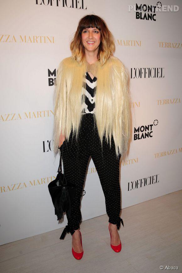 Daphné Burki a 35 ans, retour sur ses looks les plus extravagants !   Au Festival de Cannes 2010, la veste façon chevelure ne lui fait pas peur.