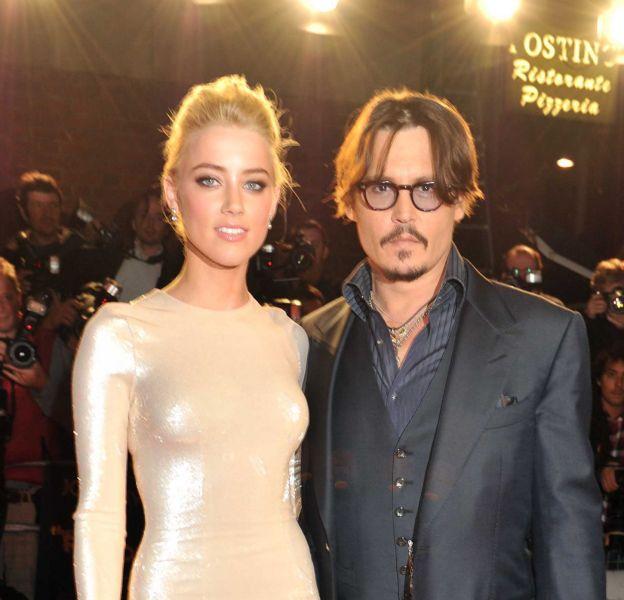 """Amber Heard et Johnny Depp : leurs plus belles apparitions sur le red carpet. Ici en 2011 lors de la promo de """"Rhum express""""."""