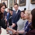 Le prince William et Kate Middleton à l'ambassade des Etats-Unis de Londres pour signer le livre de condoléances en hommage aux victimes de l'attentat d'Orlando, le 14 juin 2016.