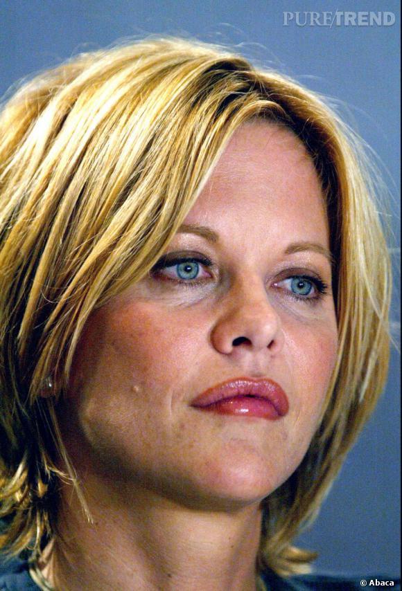 Le flop beauty look :  les cheveux jaunes et la bouche trop maquillée, Meg Ryan met l'accent sur ses défauts.