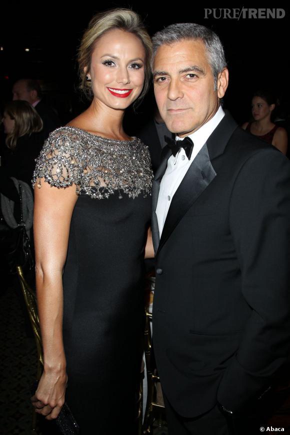 George Clooney et accompagnée de sa girlfriend Stacy Keibler étincelante dans sa robe Marchesa.