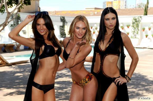 Alessandra Ambrosio, Candice Swanepoel et Adriana Lima flirtent avec l'objectif sur le shooting de la nouvelle collection de maillots de bain de Victoria's Secret.