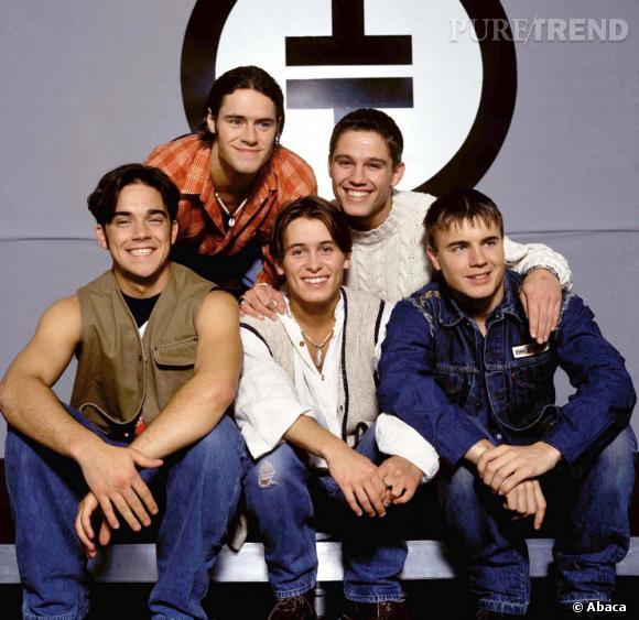 Le monde découvre le jeune Robbie Williams en 1991 en tant que membre du boys band Take That.