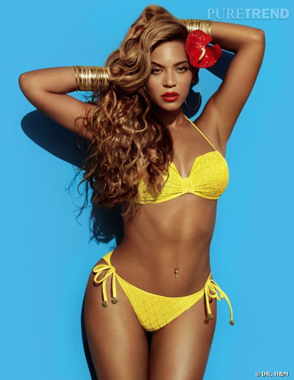 Beyoncé en bikini jaune et hibiscus dans les cheveux pour H&M.