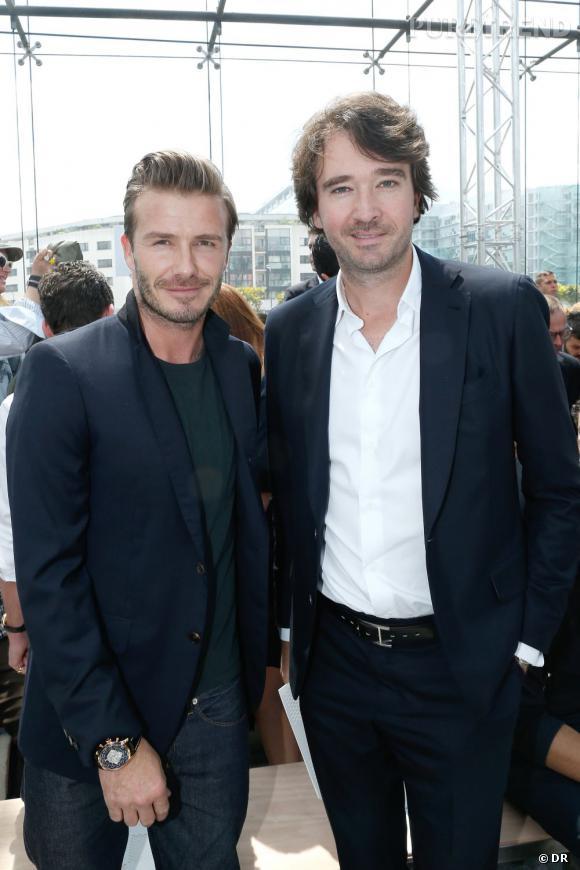 David Beckham aux côtés d'Antoine Arnault au défilé Homme Louis Vuitton Printemps-Été 2014.
