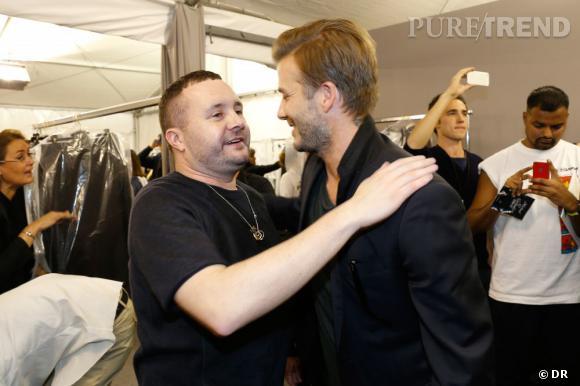 Kim Jones, directeur du style homme de Louis Vuitton et David Beckham dans les backstages du défilé Homme Louis Vuitton Printemps-Été 2014.