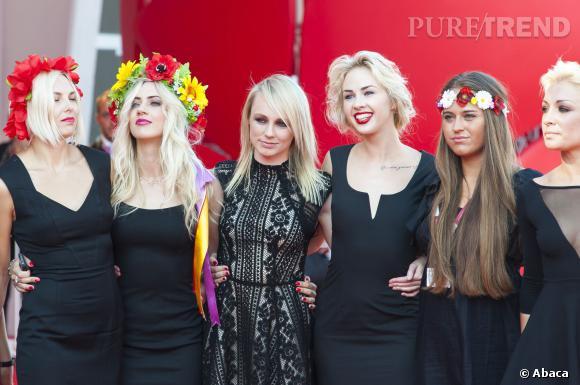 """Contrairement à ce que l'on aurait pu attendre des Femen, elles n'ont pas laissé tomber le haut hier lors de la projection du film """"Sacro Gra"""" à la Mostra de Venise."""