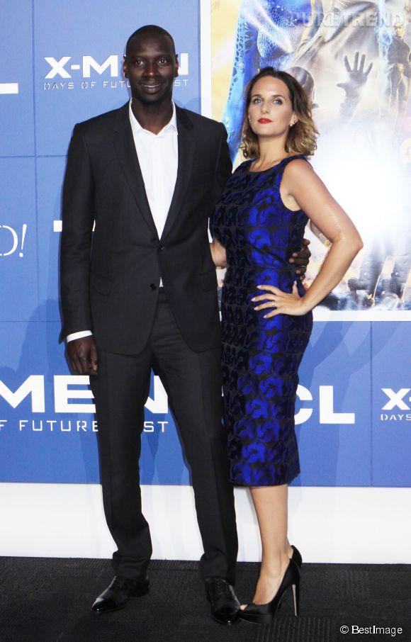 """Omar Sy et Hélène, complice et glamour à la première de """"X-Men, days of the future past""""."""