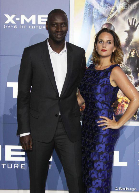 """Omar Sy et Hélène, couple glamour à la première de """"X-Men, days of the future past""""."""