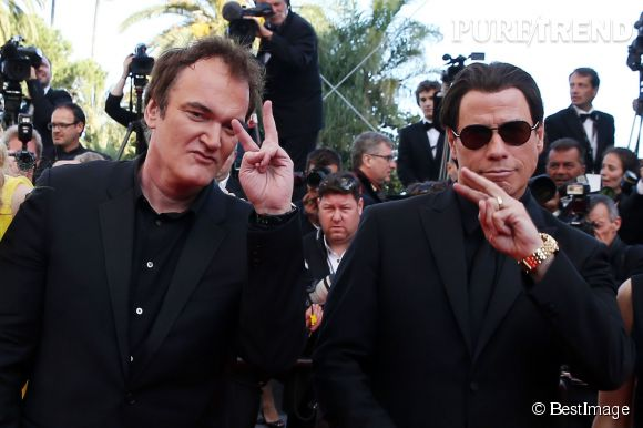 """Cannes 2014 : Quentin Tarantino et John Travolta nous rejouent """"Pulp Fiction"""" lors de la montée des marches du 23 mai."""
