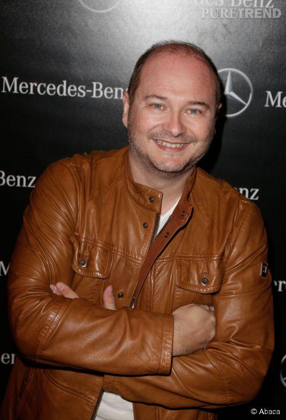 Cauet, toujours le sourire, lors de l'ouverture du pop up Mercedes le 11 mars 2014.