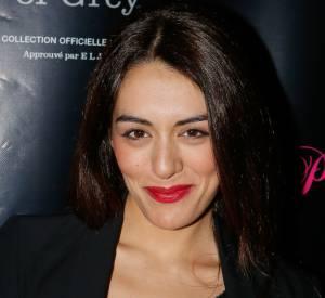 Sofia Essaïdi, femme fatale avec sa bouche rouge.