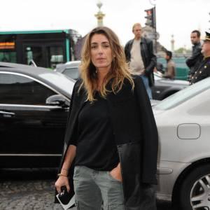"""Mademoiselle Agnès cède au léopard avec des bottines """"Big Lips Booty"""" de Christian Louboutin."""