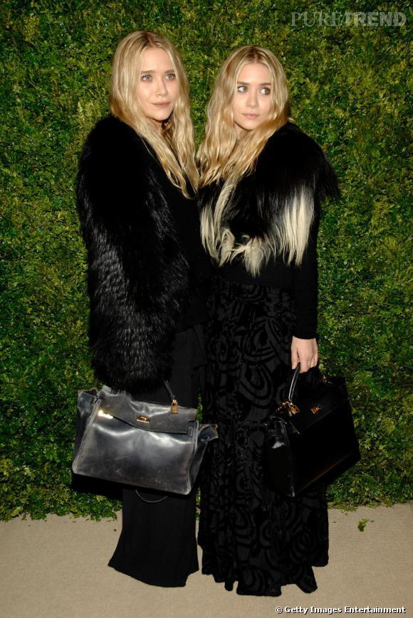 Mary Kate et Ashley se donnent des allures cloch'star version luxe ! Recette : empiler les matières les unes sur les autres afin d'obtenir une masse informe... effet garanti.