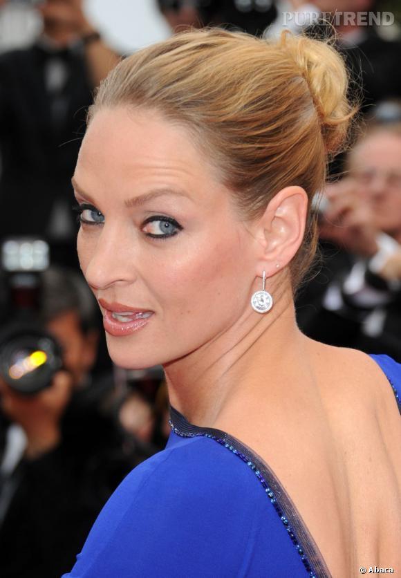 Uma Thurman à la 64e cérémonie de clôture du festival de Cannes porte des boucles d'oreille Chopard.
