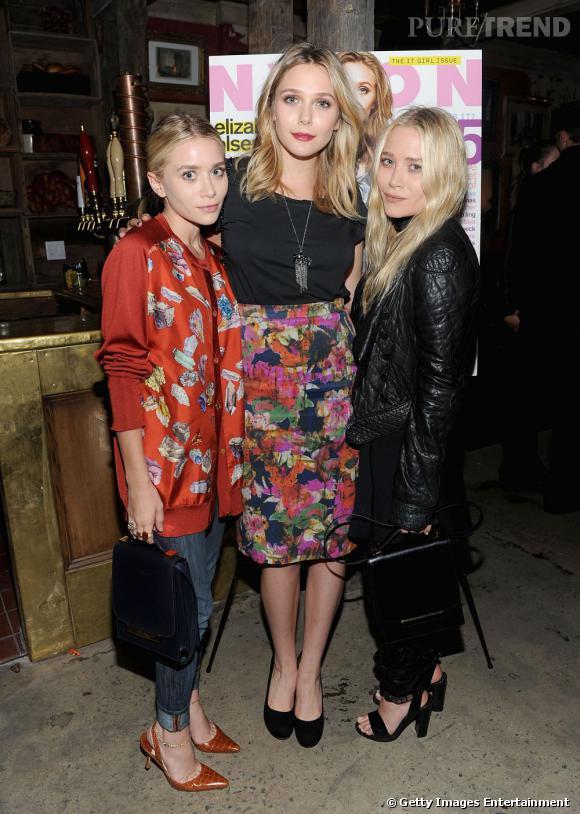 Mary-Kate mise sur une total look noir tandis qu'Ashley reste plus colorée, avec une allure parfaitement vintage.