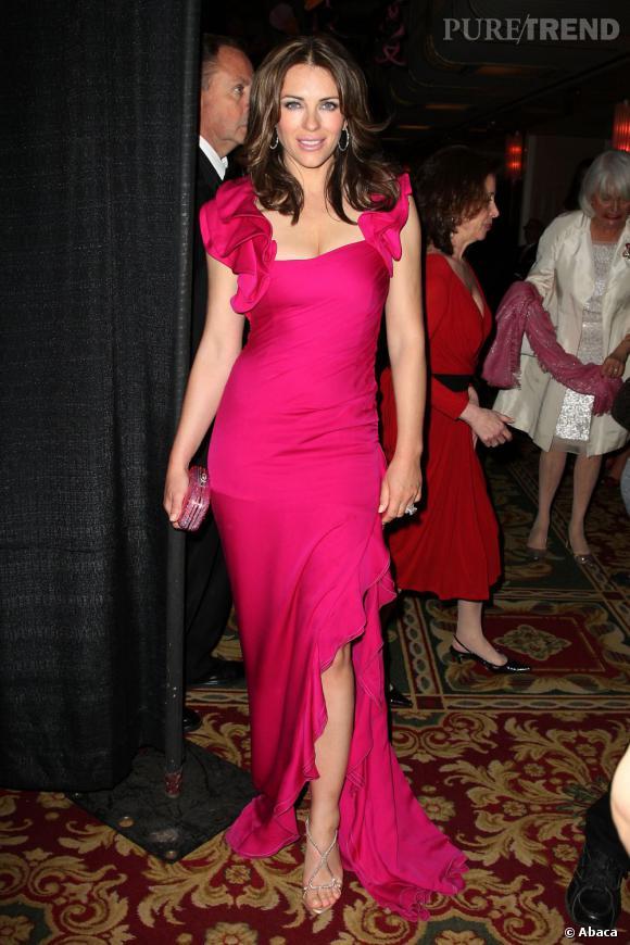 Même chez Valentino, le spécialiste du rouge, Liz craque pour un rose fuchsia.