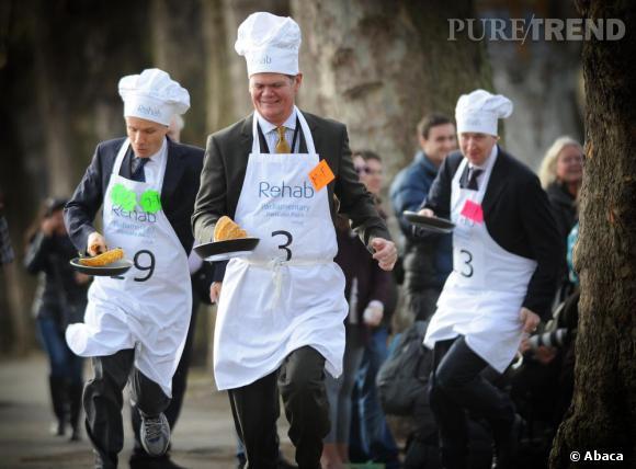 Les parlementaires anglais en pleine course de pancakes à Westminster. Plus fun que la Fashion Week ?