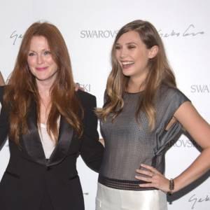 Nadja Swarovski, Julianne Moore et Elizabeth Olsen pour une soirée honneur à la marque de bijoux Swarovski.