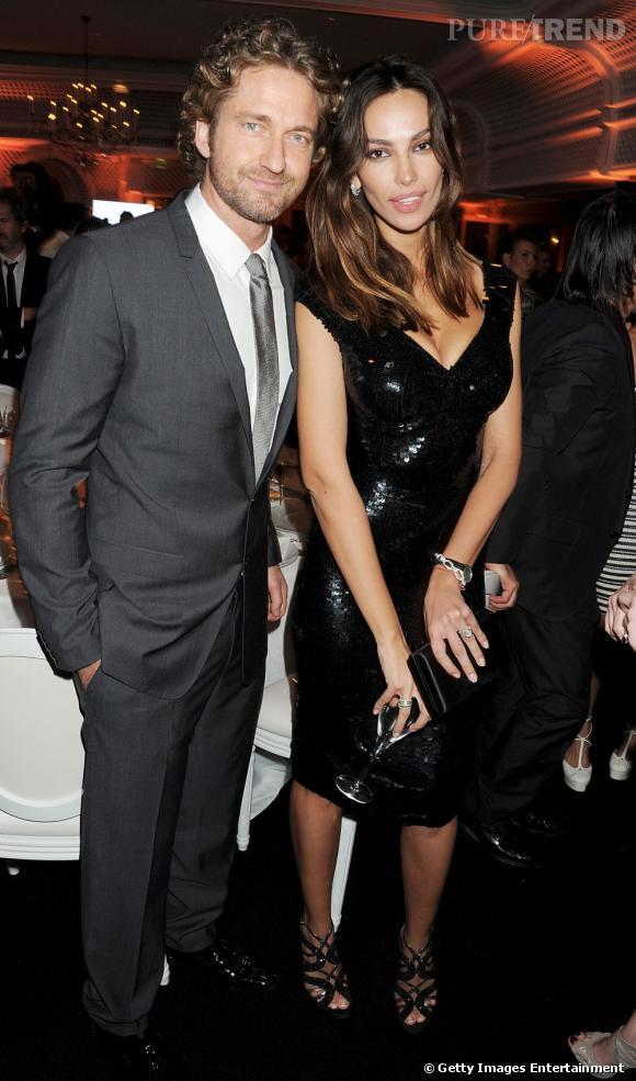 Vous vous demandez qui est la jolie brune aux côtés de Gerard Butler ? C'est Madalina Ghenea, une mannequin pour lingerie...