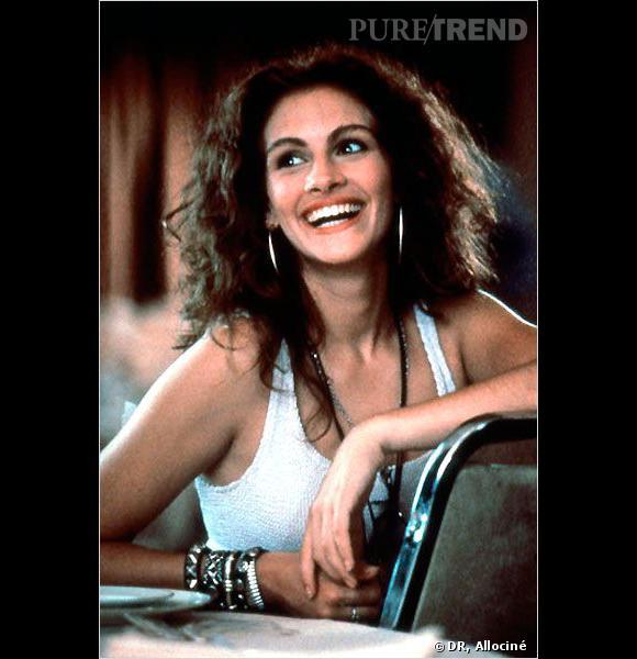 Tout le charme de Julia Roberts dans Pretty Woman se révèle dans sa crinière wild et son large sourire.