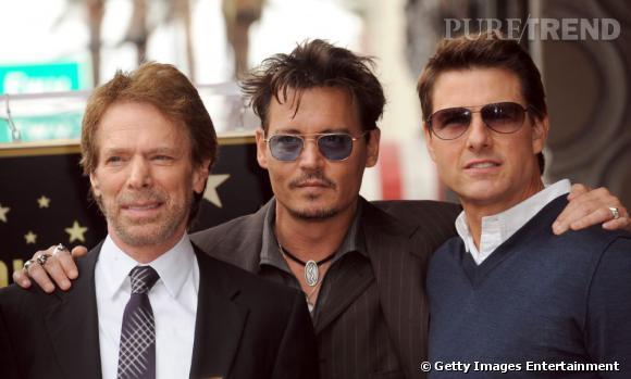 """Johnny Depp, Tom Cruise et Jerry Buckheimer qui a produit """"Top Gun"""", """"Pirates des Caraïbes"""" ou encore """"Lone Ranger"""", des films qui parlent aux deux acteurs."""