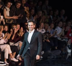 Marc Jacobs et son petit ami lors du défilé Louis Vuitton Printemps-Eté 2014.
