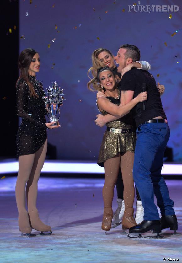 """Norbert Tarayre et Sarah Abitbol remportent la première saison de """"Ice Show"""". Pour la remise du trophée, Clara Morgane les rejoint."""