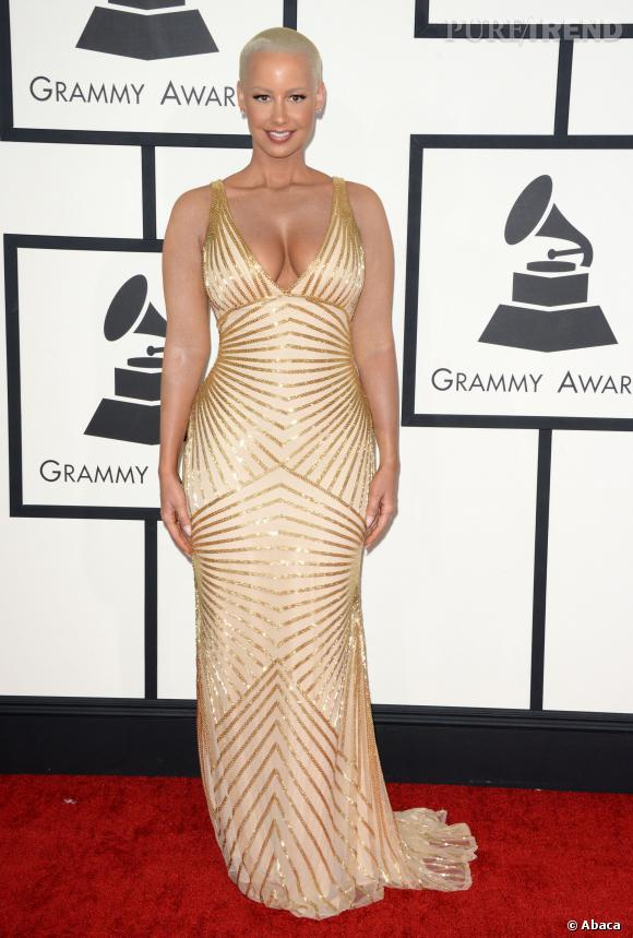 Décolleté à tomber et robe doré pour Amber Rose.