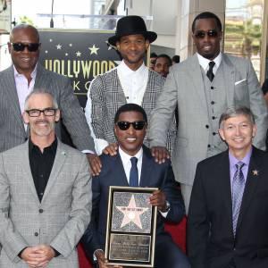 L.A Reid n'est pas n'importe qui, ici il prend la pose avec ses potes Babyface, Usher et P.Diddy le 10 octobre 2013.
