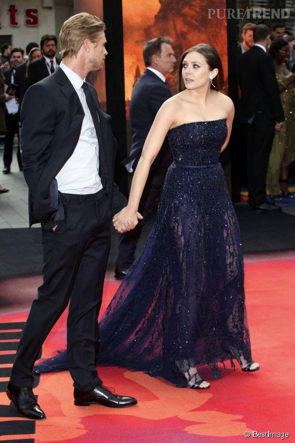 Elizabeth Olsen, sublime en Elie Saab haute couture à l'avant-première de Godzilla à Londres le 11 mai 2014. La fierté de Boyd Holbrook.