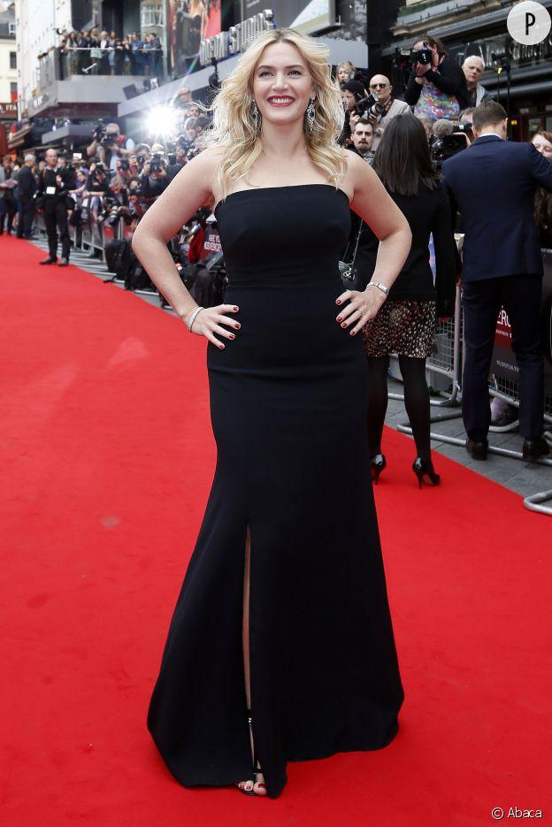 """Kate Winslet lors de la première européenne de """"Divergente"""", à Londres le 30 mars dernier. La star de """"Titanic"""" est canon en robe bustier, avec son sourire triomphant."""